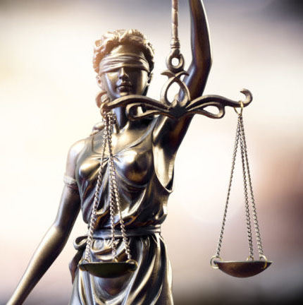 Statue of lady justice holding scales reflecting our firm's values